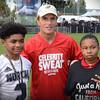 NFL Alumni Doug Flutie with young athletes