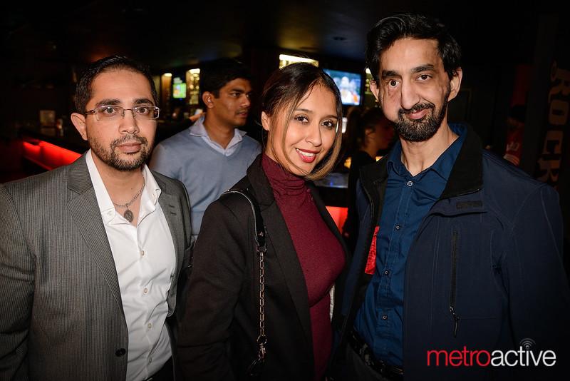 Illustrator Ali Akbar (far right) with fans of his work