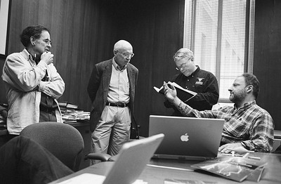 Fed (far right) in discussion with the director of the PSC and his associates.