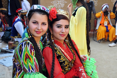 Girls from Tajikistan in their colourful ethnic costumes at the Surajkund Crafts Mela.  Surajkund Crafts Mela 2011 held near Delhi in Faridabad, Haryana, North India. The annual Suraj Kund Mela (fair) is an event held in February each year where artisans, craftsmen, musicians & dancers come together and entral thousands of visitors. It is also a great shopping bonanza and delight to the palate with the range of food.