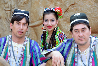 Performing artists from Tajikistan in colourful ethnic costumes add to the vibrant mood at the Surajkund Crafts Mela.  Surajkund Crafts Mela 2011 held near Delhi in Faridabad, Haryana, North India. The annual Suraj Kund Mela (fair) is an event held in February each year where artisans, craftsmen, musicians & dancers come together and entral thousands of visitors. It is also a great shopping bonanza and delight to the palate with the range of food.