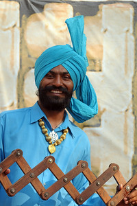 Rajan Singh from Batala, Punjab. Members of the Police band doing the Bhangra and Punjabi songs.  Artists & award winning performers from around the country came to Surajkund Mela 2009, Haryana, North India.   The theme state was MP (Madhya Pradesh). The Surajkund Crafts Mela is an annual fair held near Delhi. Folk dances, musical performances, handicrafts on display & sale and and a lot of fun & excitement for everyone.