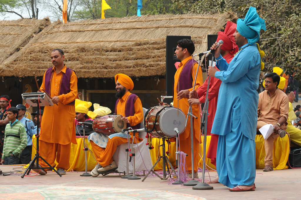 The energetic Police band performing the Punjabi Bhangra at the Surajkund Crafts Mela 2009, Haryana, North India. The Suraj Kund Mela is an annual fair held near Delhi. Folk dances, musical performances, handicrafts on display & sale and and a lot of fun & excitement for everyone.