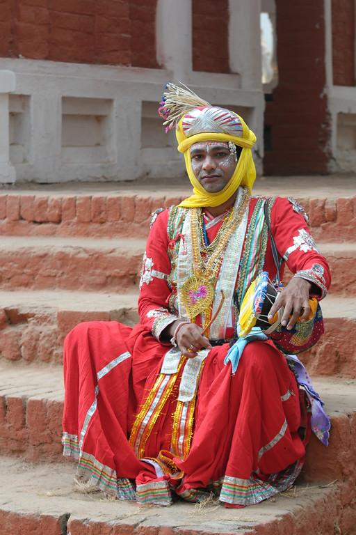 Manilal Malviya from Jila Harda, MP (Madhya Pradesh) with his damru. Artists at the Surajkund Crafts Mela 2009, Haryana, North India. The Suraj Kund Mela is an annual fair held near Delhi. Folk dances, musical performances, handicrafts on display & sale and and a lot of fun & excitement for everyone.