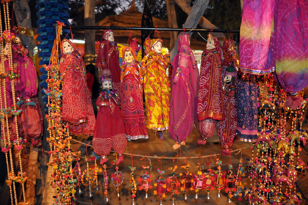 Colourful dolls and other assorted items on sale at Surajkund Mela.