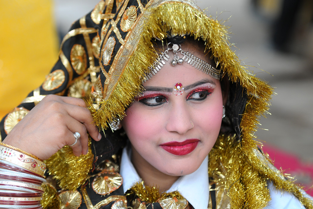 Younger sister of Ms. Pallvi who is also a dancer with the Haryanvi Group sitting near the open theatre called Chaupal at Suraj Kund Mela 2009. Held in Haryana (outskirts of Delhi), North India, the Suraj Kund Mela is an annual fair held near Delhi. Folk dances, handicrafts and a lot of fun.