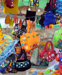 Bags and purses of various size and colours on display and sale at Suraj Kund Mela 2009 held in Haryana (outskirts of Delhi), North India. The Suraj Kund Mela is an annual fair held near Delhi. Folk dances, handicrafts and lots of delicious food.