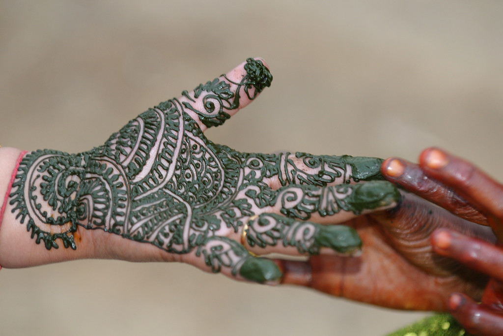Process of applying mehendi (sort of temporary tatoo) on the hands of ladies at Surajkund Mela. Suraj Kund Mela 2009 held in Haryana (outskirts of Delhi), North India. The Suraj Kund Mela is an annual fair held near Delhi. Folk dances, handicrafts and a lot of fun.