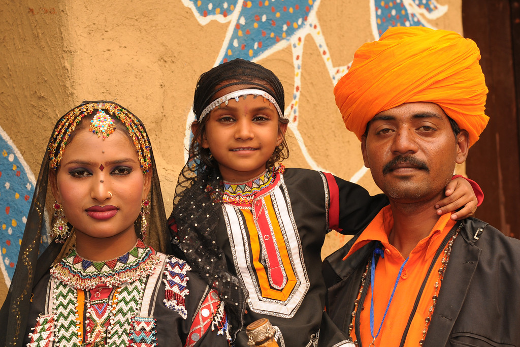 Artists from the Rajki-Puran Nath Sapera & Party group, Jaipur photographed at the Suraj Kund Mela 2009 held in Haryana (outskirts of Delhi), North India. Artists from around the country come to the Surajkund Crafts Mela 2009, Haryana, North India. The Suraj Kund Mela held near Delhi has folk dances, musical performances, handicrafts on display & sale and and a lot of fun & excitement for everyone.