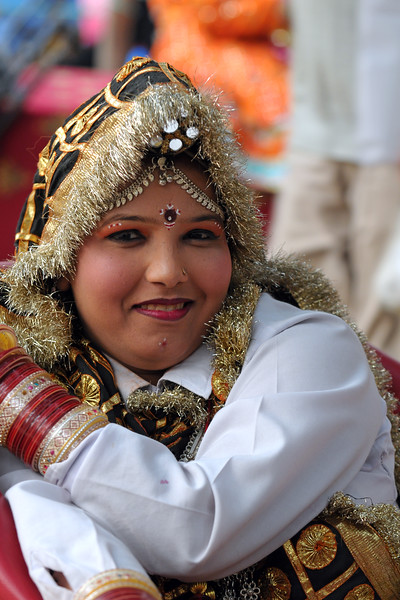 Ms. Pallvi who is a dancer with the Haryanvi Group sitting near the open theatre called Chaupal at Suraj Kund Mela 2009. Held in Haryana (outskirts of Delhi), North India, the Suraj Kund Mela is an annual fair held near Delhi. Folk dances, handicrafts and a lot of fun.