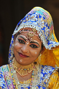 Dancer from Goverdhan (Mathura) who perform the Birj Ki Holi (Radha Kishan) near the open theatre called Chaupal at the Suraj Kund Crafts Mela which is an annual fair held near Delhi in February. Visitors get to experience folk dances, handicrafts and taste lots of delicious food.