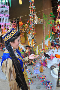 Tajikistani girls shopping after their performance at the Chaupal. Plenty of opportunity for shopping deals, bargains and purchases or just enjoy the performances at the Surjakund Crafts Mela 2010 held in February in Faridabad, Haryana, India.