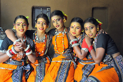 Group picture of the girls from Dayal Sangeet Academy, Rasulgargh, Bhubaneshwar, Orissa who perform Odissi and Sambalpuri folk dance getting ready at Surakund Mela 2010. The Suraj Kund Crafts Mela 2010 is an annual fair held in Haryana near Delhi in February.