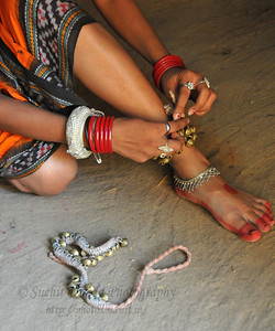 Girls from Dayal Sangeet Academy, Rasulgargh, Bhubaneshwar, Orissa who perform Odissi and Sambalpuri folk dance getting ready wearing ghungaroos (anklet bells) at Surakund Mela 2010. The Suraj Kund Crafts Mela 2010 is an annual fair held in Haryana near Delhi in February.
