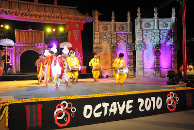 Dhon Dholak Dance, Manipur. Highly acclaimed show of drummers is the Dhon Dholak which is known for its agility and skill while performing the Dhon-Dhulok Cholom. Vigrous beating of drums and flying body movements in tandem with rhythmic talas is the character of this dance. It is closely associated with the famous Holi of Manipur. The performance of North East Octave Group added to the majestic splendour of the Mela. Octave 2010 brought the rich cultural diversity and hertiage from eight North-Eastern states of India - Assam, Meghalaya, Tripuar, Manipur, Mizoram, Nagaland, Arunachal Pradesh, and Sikkim. In association with Ministry of Culture, Government of India and North Central Zone Cultural Centre, Allahabad. This performance was the largest group performers at the Surjakund Crafts Mela 2010 held in February in Faridabad, Haryana, India.