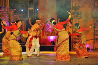 Dholar Cholona Dance, Assam. Dhol (drum) is a popular folk music instrument. Assamese people use two type of dhol - bihu dhol and wedding dhol. The dhol player is known as Oja. The performance of North East Octave Group added to the majestic splendour of the Mela. Octave 2010 brought the rich cultural diversity and hertiage from eight North-Eastern states of India - Assam, Meghalaya, Tripuar, Manipur, Mizoram, Nagaland, Arunachal Pradesh, and Sikkim. In association with Ministry of Culture, Government of India and North Central Zone Cultural Centre, Allahabad. This performance was the largest group performers at the Surjakund Crafts Mela 2010 held in February in Faridabad, Haryana, India.