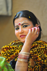 On the (mobile) phone... Dancer from Goverdhan (Mathura) who perform the Birj Ki Holi (Radha Kishan) near the open theatre called Chaupal at the Suraj Kund Crafts Mela which is an annual fair held near Delhi in February. Visitors get to experience folk dances, handicrafts and taste lots of delicious food.
