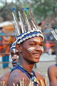 Siddi tribe at Surajkund. The foot tapping and soul stirring music of their 'Siddhi Gorma' dance truly reflected the diverse culture of Gujarat. This dance traces its origins to the Afro music brought by african immigrants. Imran Siddi commenting on his tribal culture said that their tribes have got  an inclination towards religion & spiritualism and dance and music are the only forms of expression. He feels that it is a kind of a spiritual devotion to his ancestors every time he dances on the stage.  Siddi tribe performers at the open theatre called Chaupal at the Suraj Kund Crafts Mela 2010 which is an annual fair held near Delhi in February.