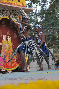 Siddi tribe at Surajkund. The foot tapping and soul stirring music of their 'Siddhi Gorma' dance truly reflected the diverse culture of Gujarat. This dance traces its origins to the Afro music brought by african immigrants. Imran Siddi commenting on his tribal culture said that their tribes have got  an inclination towards religion & spiritualism and dance and music are the only forms of expression. He feels that it is a kind of a spiritual devotion to his ancestors every time he dances on the stage.  Siddi tribe performers at the open theatre called Chaupal at the Suraj Kund Crafts Mela 2010 which is an annual fair held near Delhi in February. Visitors get to experience folk dances, handicrafts and taste lots of delicious food.