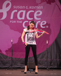 Sarah Charness playing the National Anthem on her pink electric violin.