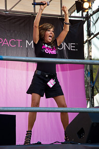 """Close to 50,000 breast cancer survivors and activists descended on the National Mall in Washington D.C. on June 5, 2010 for the 21st annual Susan G. Komen Global Race for the Cure. Participants were treated to a live performance of """"Pink Warrior,"""" an inspiring song by singer/songwriter Candy Coburn. Coburn also debuted her soon-to-be released single """"Ain't No Rodeo.""""The event raises millions of dollars for the fight against breast cancer. (Photo by Jeff Malet)"""
