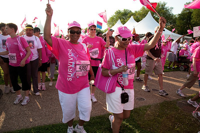 "Thousands gather on the National Mall in Washington D.C. on June 5, 2010 for the 21st annual Susan G. Komen Global Race for the Cure. The event raises millions of dollars for the fight against breast cancer. The morning's festivities opened with the Parade of Pink, as nearly 3,500 breast cancer survivors and international representatives marched into the mall to a live performance of ""Pink Warrior,"" an inspiring song by singer/songwriter Candy Coburn. (Photo by Jeff Malet)"