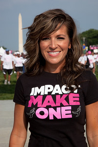 "Country singer Candy Coburn poses on the National Mall. Close to 50,000 breast cancer survivors and activists descended on the National Mall in Washington D.C. on June 5, 2010 for the 21st annual Susan G. Komen Global Race for the Cure. Participants were treated to a live performance of ""Pink Warrior,"" an inspiring song by singer/songwriter Candy Coburn. Coburn also debuted her soon-to-be released single ""Ain't No Rodeo.""The event raises millions of dollars for the fight against breast cancer. (Photo by Jeff Malet)"
