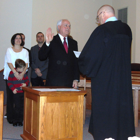 Diane Raver | The Herald-Tribune<br /> Clerk-treasurer Paul Gates takes the oath of office.