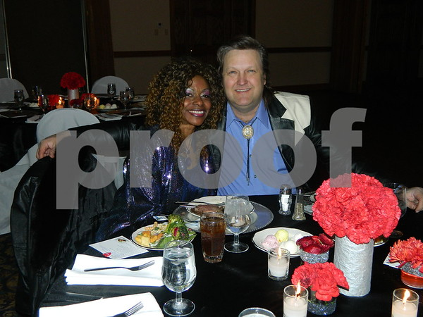 left to right: Awendl and Anderson having dinner together before the auction