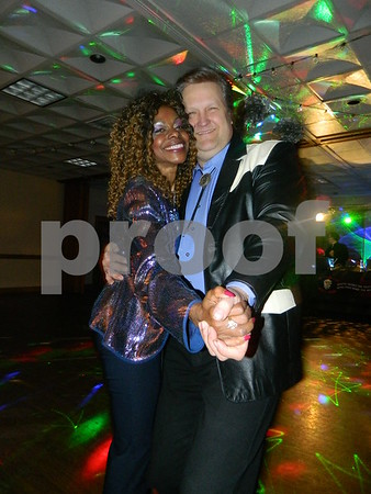 Awendl, and Anderson dancing the night away after the auction