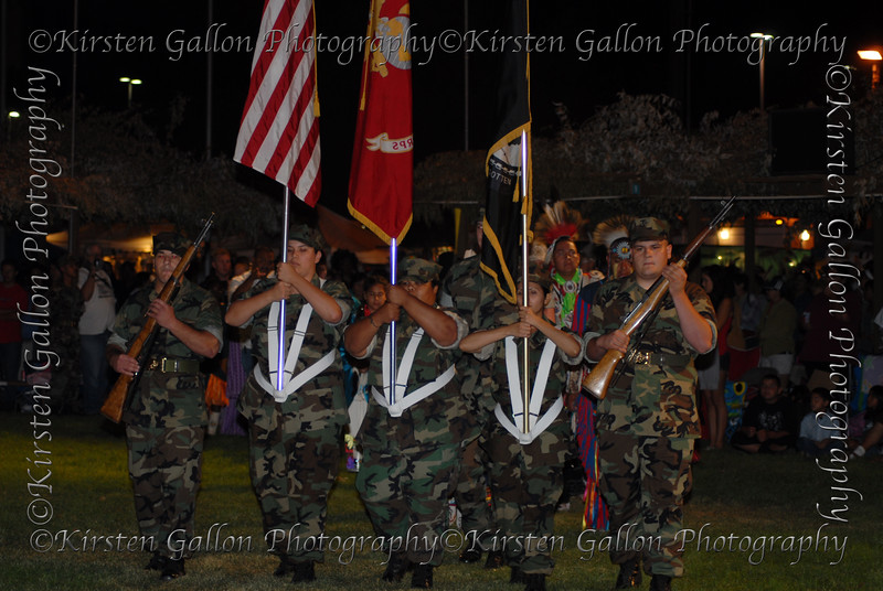 The colorguard leads the Grand Ceremony procession the evening of the 8th.