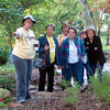 Cynthia guides a tour of the Benny Simpson Gardens at TWU