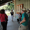Riverside Nature center docent speaks to several field trip participants.