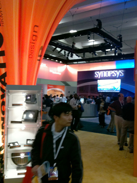 Looking through the Design Innovation booth toward Synopys