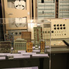 Little hand-wired circuit boards next to another huge cabinet (check out the lovely 1960s desk unit).