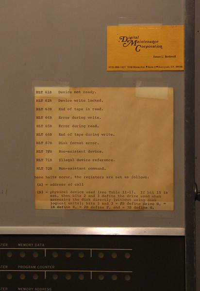 "This note deciphers the machine's cryptic error messages, such as ""HLT63B End of tape in read."" Well, that explained everything (not)! Notice that the card taped above is for the maintenance engineer."