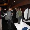 Customers line up to spin for a prize at the Support Center booth.