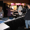 Customers receive prizes at the Support Center booth.