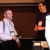 Osman Eralp talks with a customer at the documentation kiosk.