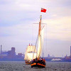 Liana's ransom in front. The Nova Scotia flag is flown  because her original home port was Halifax. A replica of an eighteenth century schooner.