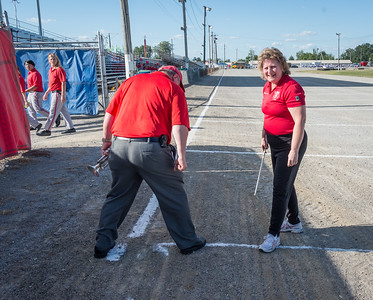 We were reminded to avoid stepping on lines painted for the evening's Showcase of Bands.  Randy and Shelley have a bit of fun with the caution!