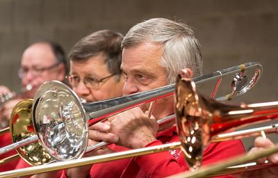 Trombones warm up for the Men's game