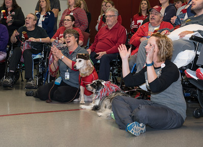 The standing-room-only audience included patients, volunteers, staff...and therapy dogs