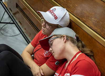 Two young volunteers grab a much-needed 40 winks