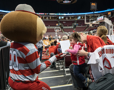 Brutus tries for a high-five from Anna