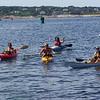 KayakAthon kayakers arrive at TI boat ramp.