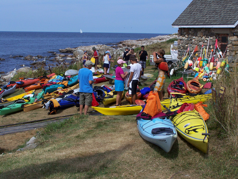 Other kayakers join the group.