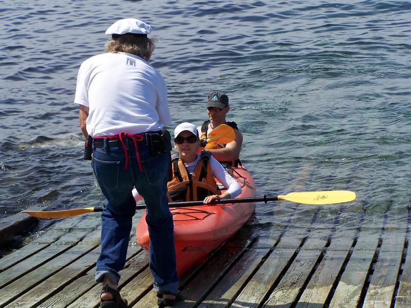 Keeper John assists arriving Kayakers.