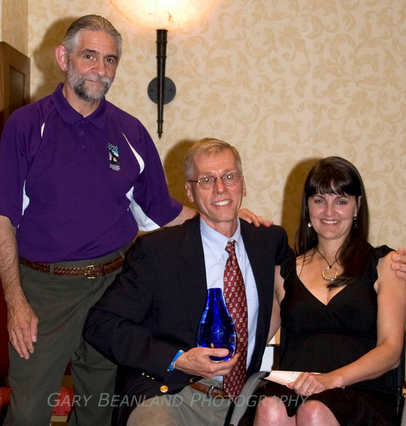 Sandford J. Siegel, President of the Transverse Myelitis Organization, Dr. Peter Sim, recipient of the 2008 TMA Distinguished Service Award, and Paula Lazzeri, TMA Treasurer