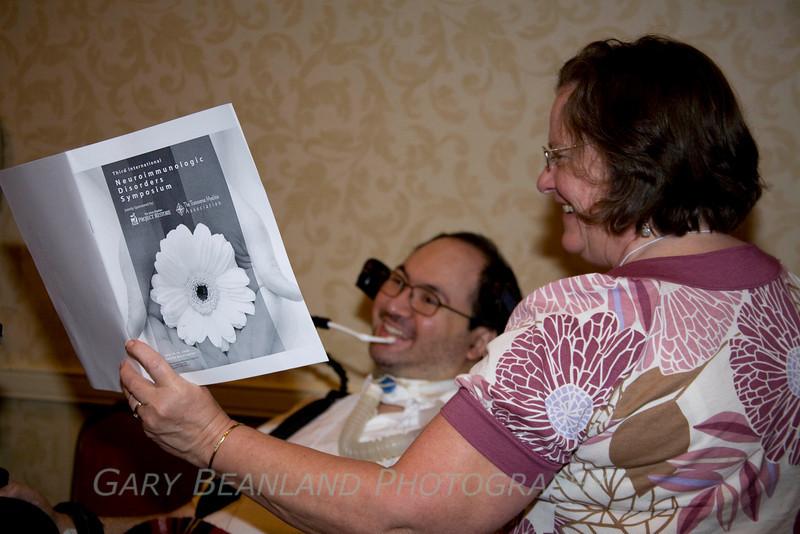 Jim Lubin and his mom review the schedule for the Symposium.